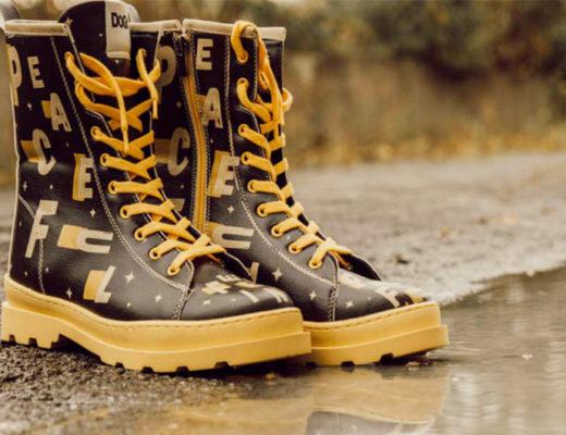 ein Paar wasserdichte Schuhe in Schwarz und Gelb mit Muster von DOGO shoes